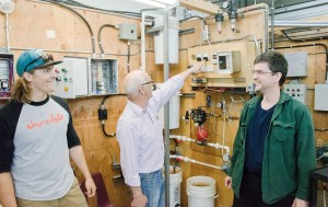 Instrumentation instructor Max Tinsley shows off Brian Wells and Johnathon Watt's final instrumentation project, an automated water pump. (Jim Elliot/The Omega)