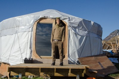 Michael Jefferey, standing outside his yurt on the north side of the South Thompson River. (Wade Tomko/The Omega)