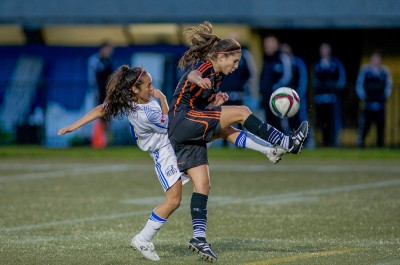 Jodi Hutton battles for the ball during TRU's playoff loss to UBC on Oct. 30. (TRU Athletics)