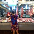 A Thai girl unloads a bag of liver at her butcher stand in a massive market in northern Bangkok. (Marlys Klossner/ The Omega)