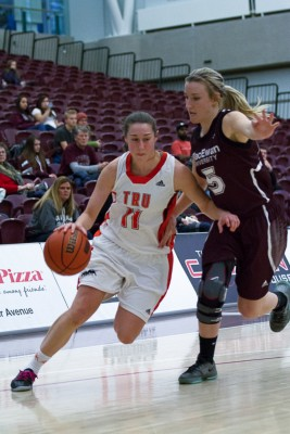 Taiysa Worsfold drives the ball past Kelly O'Hallahan during TRU's victory on Jan. 16. (Eduardo Perez/Submitted)