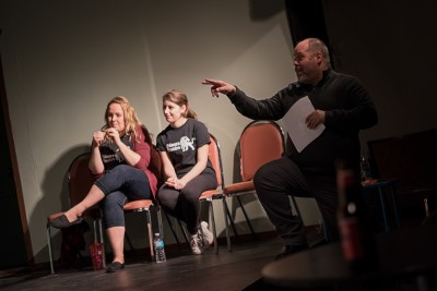 Host Derek Rein (right) explains the rules of the next theatre game while Kelsey Launier (middle) and Brittany McCarthy (left) look on. (Marlys Klossner/The Omega)