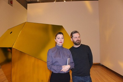 Artists Holly Ward and Kevin Schmidt in front of Ward's piece at the curator's tour in the Kamloops Art Gallery. (Jennifer Will/The Omega).