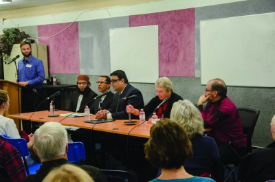 Graham Specht, Imam Mazhar Maqmood, Bill Sundhu, Faisal Siddiqui, Martha Ashbaugh and Paul Lagace take questions from the audience. (Jim Elliot/The Omega)