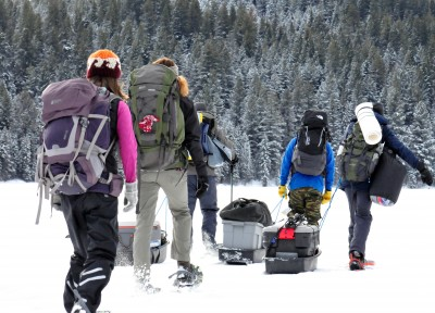 Snowshoers pack their gear to a cabin near McConnel Lake as part of the TRUSU Adventure U Outdoor Club's weekend trek. (Gabriel Rivett-Carnac/Submitted)