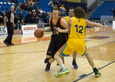TRU's leading scorer Josh Wolfram drives around a UNBC defender. (Tristan Davies/The Omega)