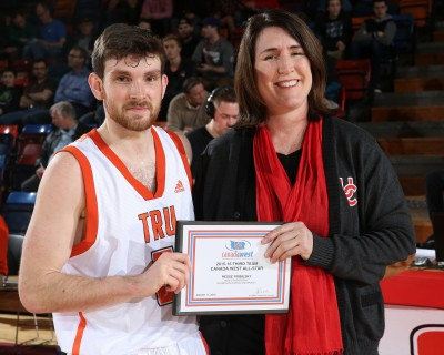 Reese Pribilsky receives his Canada West 3rd team All-Star award at one of the weekend games in Calgary. (TRU Athletics)