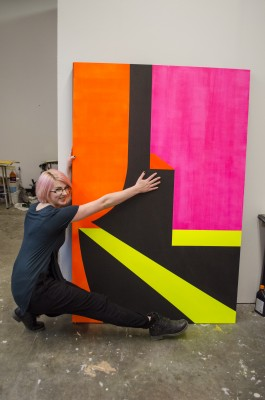 athleen Lochhead is in the process of creating two more large geometric paintings like this one, both to be part of her final project show. (Marlys Klossner/The Omega)