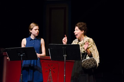 Kelsey Gilker and Anita Wittenberg perform a scene from Blithe Spirit. (Marlys Klossner/The Omega)