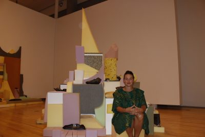 """Artist Zoe Kreye in front of one of her sculptures from the """"Our Missing Body"""" project. (Jennifer Will/The Omega)"""