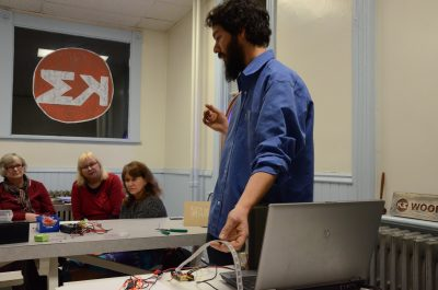 Aras Balali Moghaddam from Markerspace conducting a light workshop. (Jennifer Will/The Omega)
