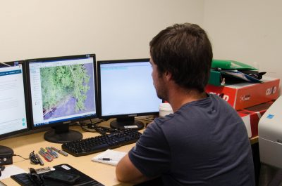 Jake Bradshaw, fourth year natural resource science honours student, analyzes an aerial map taken by a drone. Bradshaw is one of six undergraduate researchers chosen to help faculty John Church and David Hill after they received $663,940 in federal funding. (Martin Mcfarlane/The Omega)