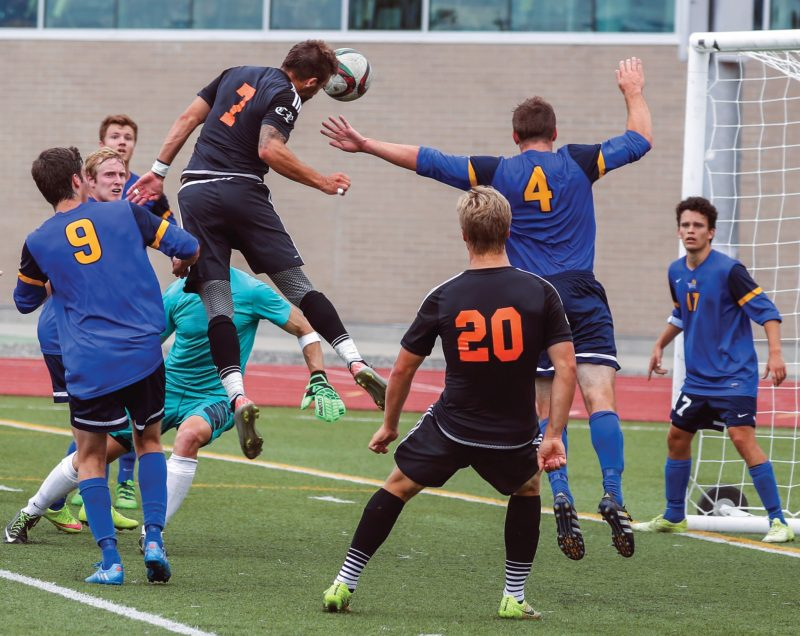 TRU's new forward, second-year midfielder Justin Donaldson, scores on a header in a late August game against the University of Victoria Vikes. This was one of four goals Donaldson scored on the weekend. (TRU Athletics)