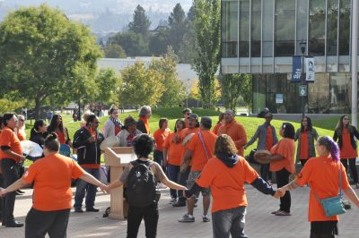 Students and faculty participate in a round dance in the Campus Commons. (Wade Tomko/The Omega)