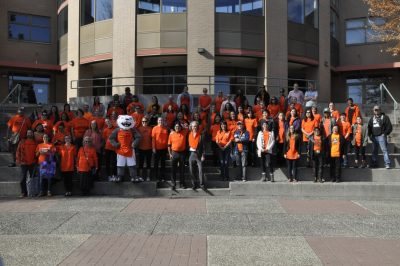 TRU President Alan Shaver, Vernie Clement with his band, students and faculty pose together for Orange Shirt Day on campus. (Wade Tomko/The Omega)