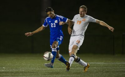The Thunderbirds' Manraj Bains (23) and Ryan Glanville get tangled up during CIS Canada West men's soccer action at UBC in Vancouver on October, 22, 2016. (Rich Lam/UBC Athletics Photo)