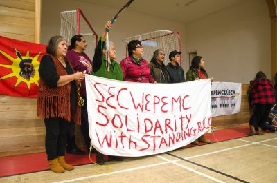 Amy George, Tsleil-Waututh chief Rueben George, Evelyn Camille, Jody Leon, Henry Saul, Keenan Phillip and Gwa (Missing: Art Manuel) holding a banner in support of the Standing Rock protest in North Dakota. The group, along with several other members of the Secwepemc First Nation have gone to Standing Rock to protest the Dakota Access Pipeline. (Martin McFarlane/The Omega)