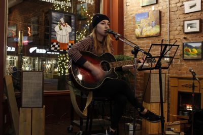 Emily O'Laney a TRU student performing at WUSC's open mic night fundraiser. (Jennifer Will/The Omega)