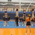 Cheerleaders in action, with coach Meaghan Blakey looking on. (Marcela Arévalo/The Omega)